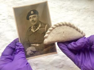 Museum staff holding the Bethlehem Pasty and an old picture of the maker Mr Jewell