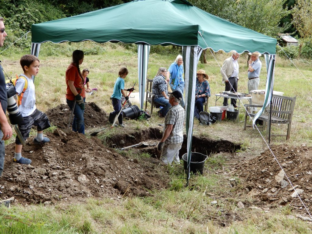 A group of people excavating with Fowey Museum