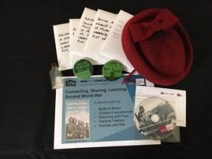 An array of items from Bodmin Keep's wartime learning pack - including a DVD, badges and information booklets.