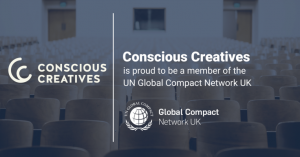 A dark photo of chairs at a conference. On the left is the 'Conscious Creatives' logo. On the right it says 'Conscious Creatives is proud to be a member of the UN Global Compact Network.'