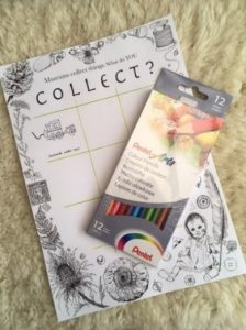 A hand-drawn activity booklet with illustrations of flowers on the cover and a pack of colouring pencils.