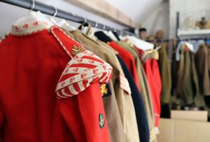 A clothes rail of colourful historic military costumes at Bodmin Keep