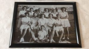 A historic photograph showing a team of young women - Porthleven Ladies' cricket team from 1949
