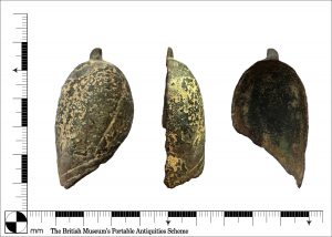 Three angles of a medieval saddle pommel